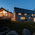 house-with-extension-at-night-casestudy-newbuild-with-extension-wesey-farm